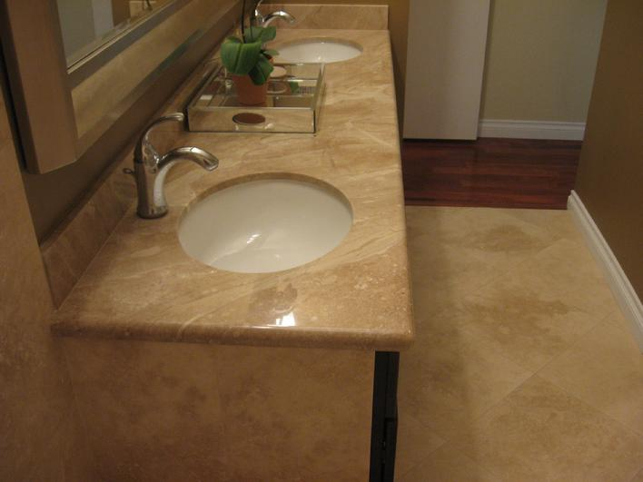 18 INCH TRAVERTINE FLOOR TILE AND COLONIAL CREAM GRANITE COUNTERTOP